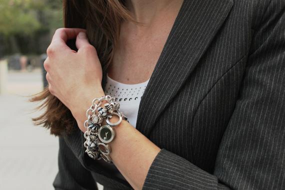closeup gray pinstripe blazer silver bracelets white rhinestone scoop neck