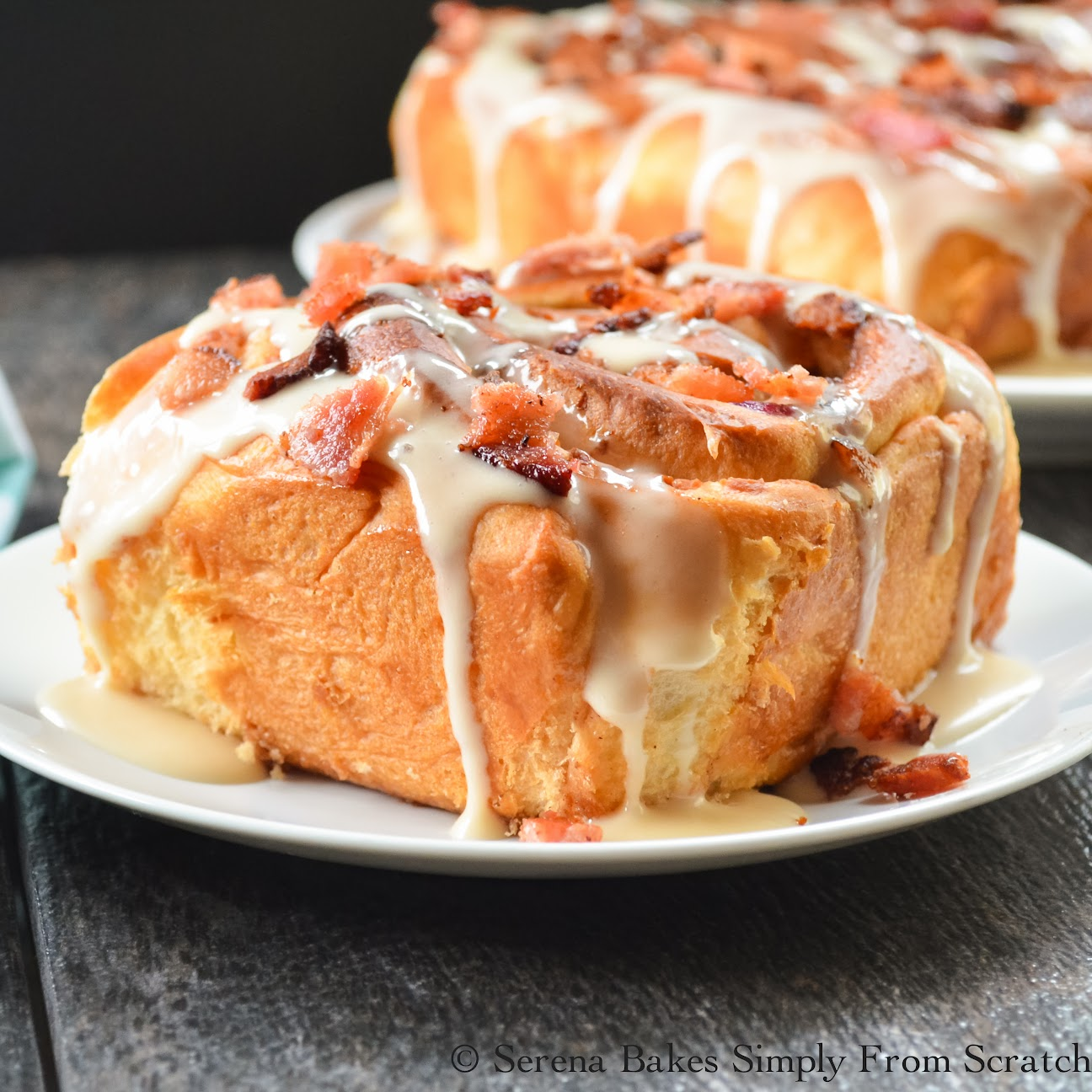 Bacon Blueberry Cinnamon Rolls with Maple Icing and bacon bits.