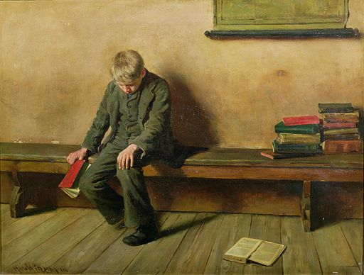 A dejected student sitting alone, book in hand