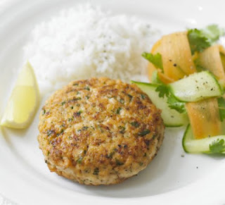 Picture of Salmon Hamburgers on white plate and lemon