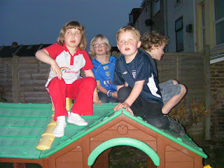 sitting on a playhouse in pub beergarden