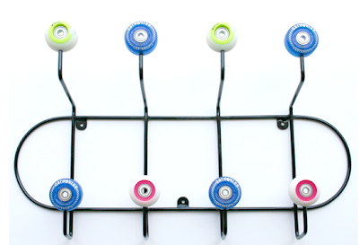 wall-mounted coat hanger made with skateboard wheels
