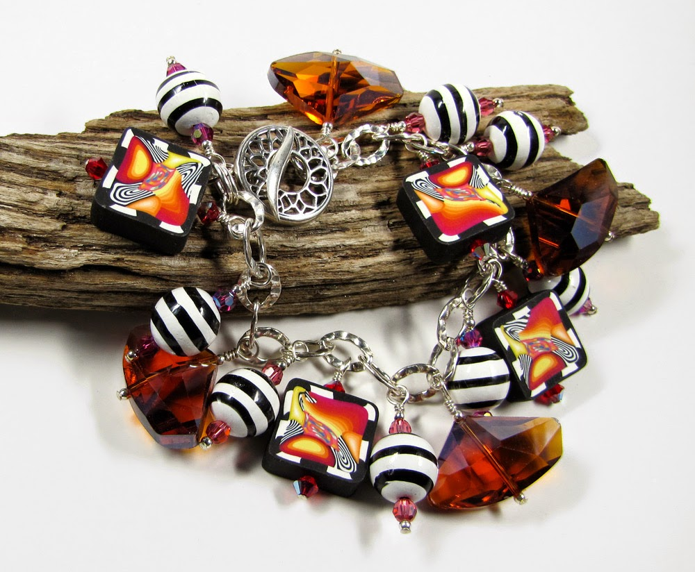 http://brackendesigns.com/product/picasso-influenced-vibrant-charm-bracelet-crystals-vintage-beads-and-polymer-clay?tid=60