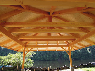 Douglas fir timbers are featured in this outdoor timber pavilion