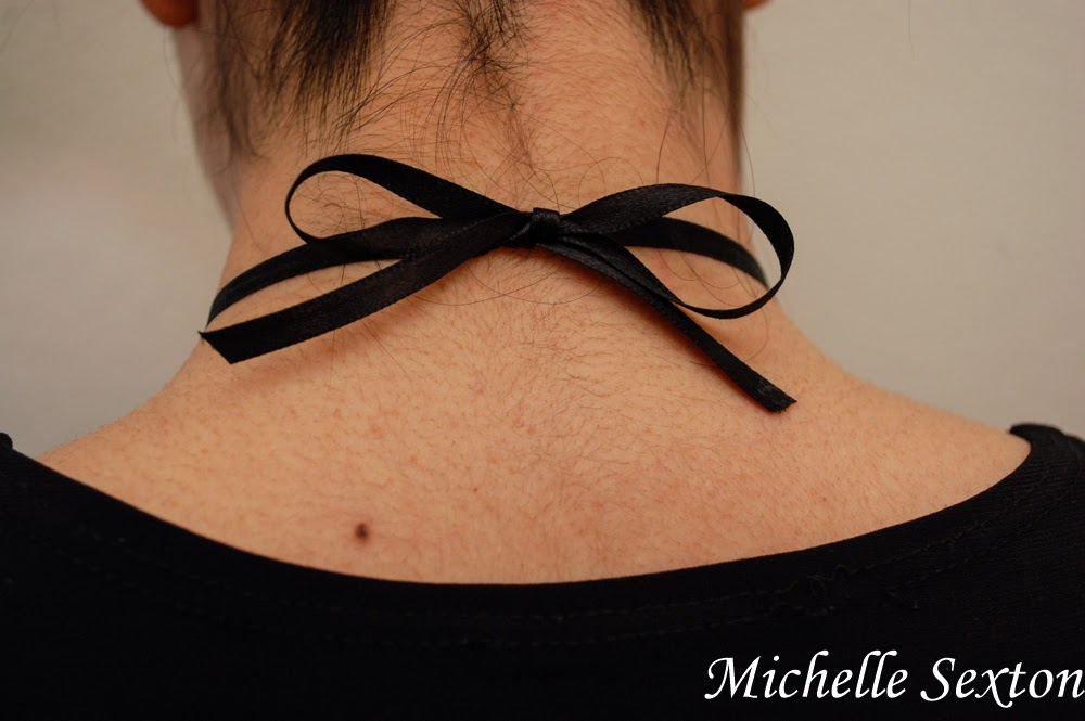 Tie a bow to wear this Safety Pin Bib Necklace