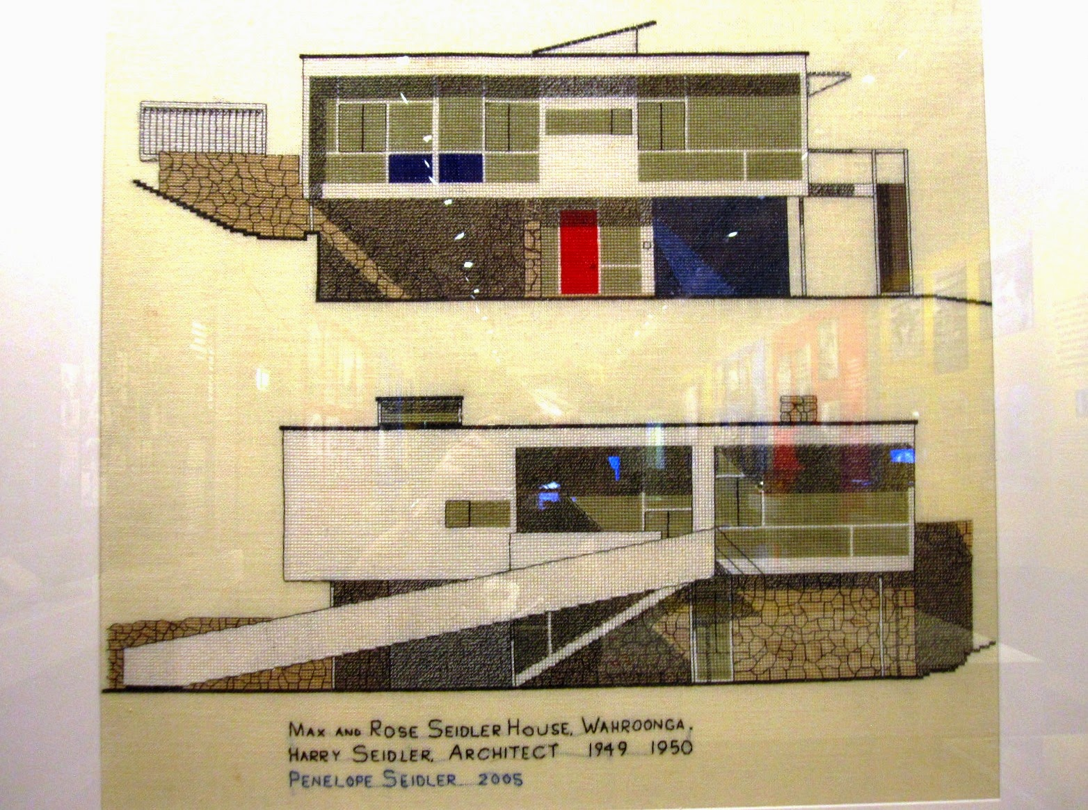 Cross-stitch picture of Rose Seidler House.