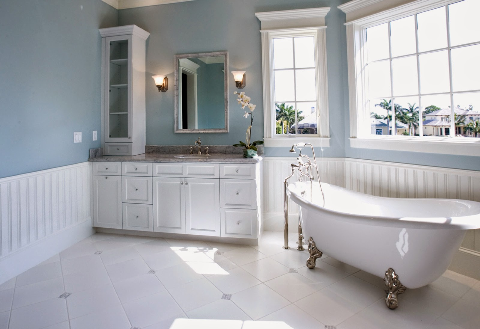 beautiful bathroom design with blue walls and white leg bathtub also