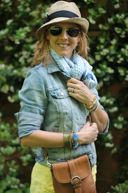 Ray Ban Aviators, Gap 1969 Denim Jacket, H&M blue and white scarf, Coach bag, H&M Shorts, World Market Earrings, Tiffany Interlocking Circles Ring, Stella & Dot Renegade and Nugget Wrap Bracelet