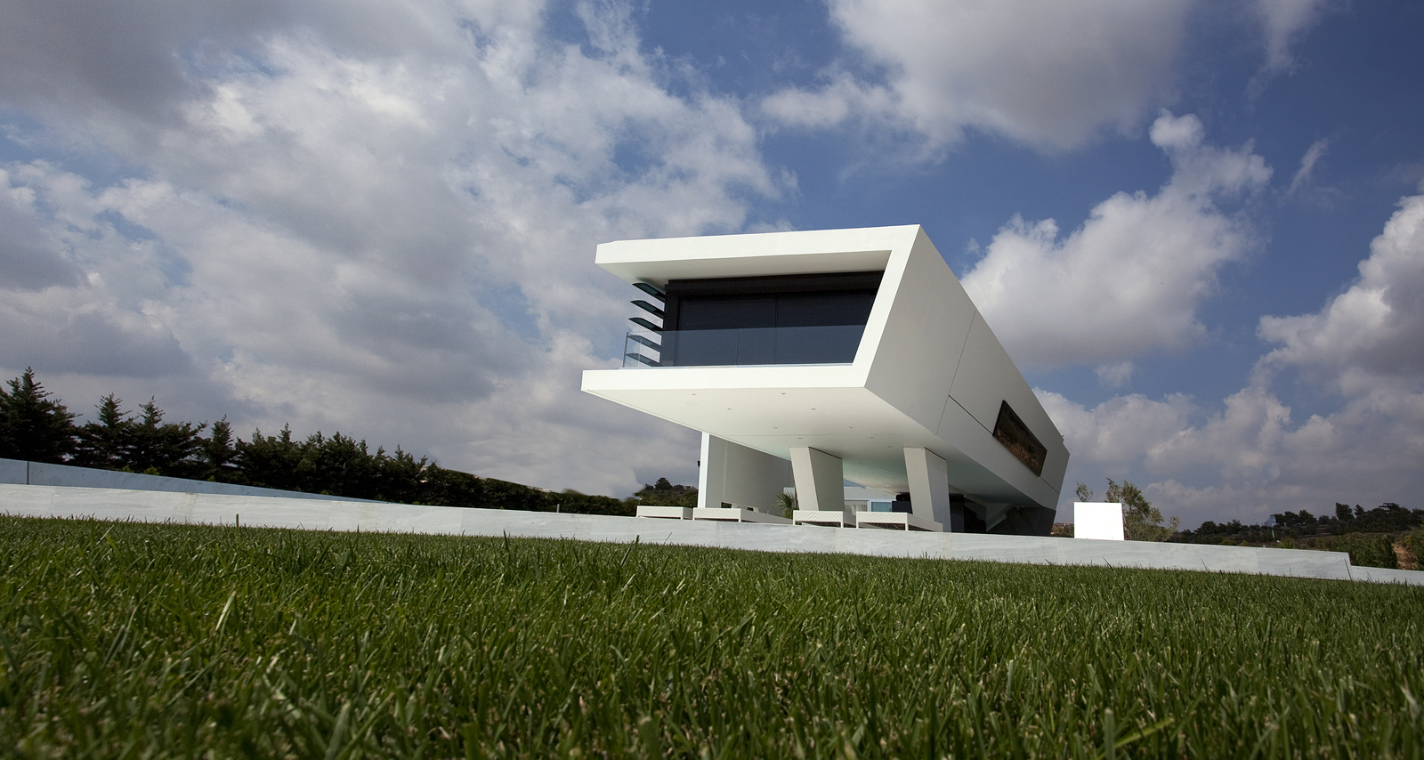 Picture of white modern home as seen from the backyard