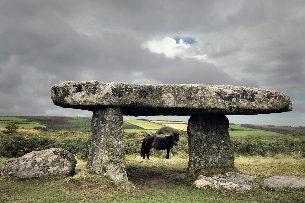 mini stonehenge and horse