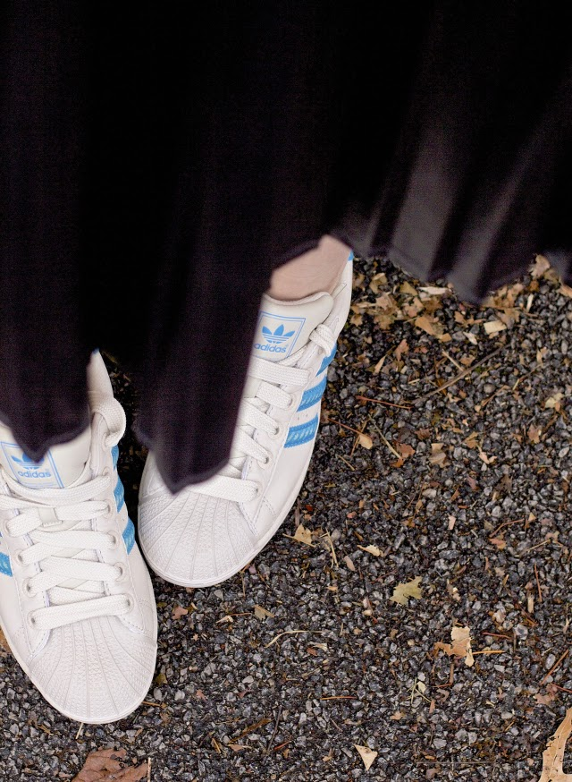 wearing adidas sneakers with a skirt