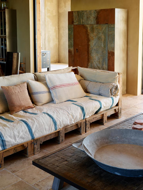 A Large Scale Wood Frame Sofa In The Living Room Was Crafted From Turkish Packing Crate That Used To Ship Travertine Marble Tiles Hales House