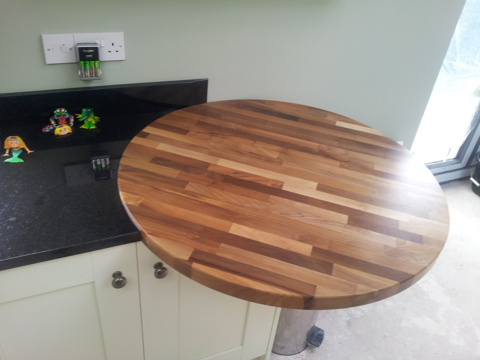 kitchens direct ni: granite meets wood at kitchens direct ni