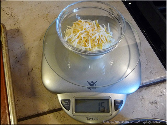 weighing shredded cheese for frico