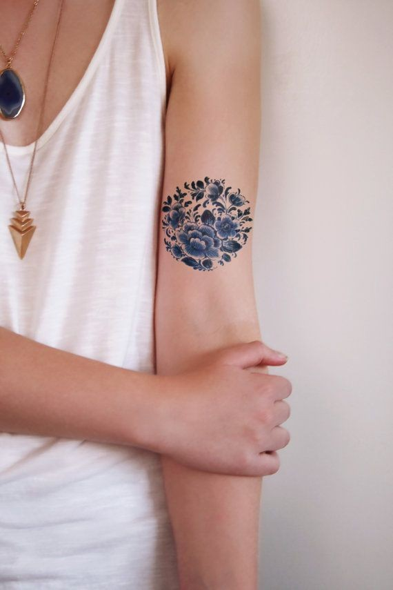 Amasing dark blue flowers tattoo on arm for girls