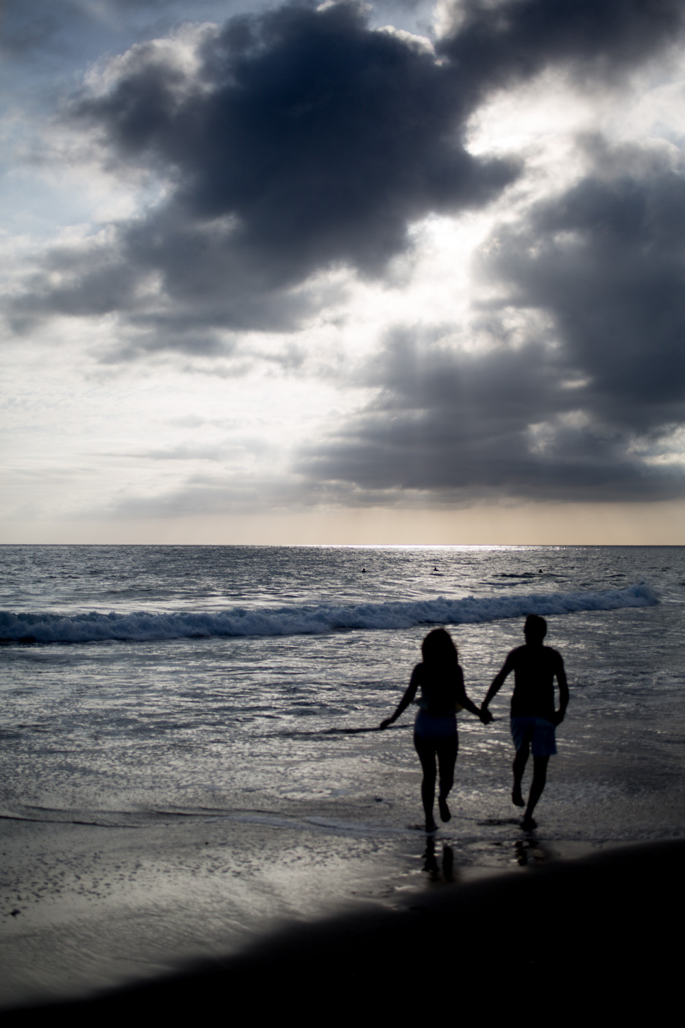 couple running off into the sunset on a beach