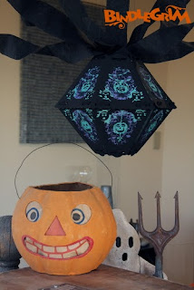 Bindlegrim vintage style Halloween lantern hangs with crepe paper over antique pumpkin and a newer ghost by Hobgoblin