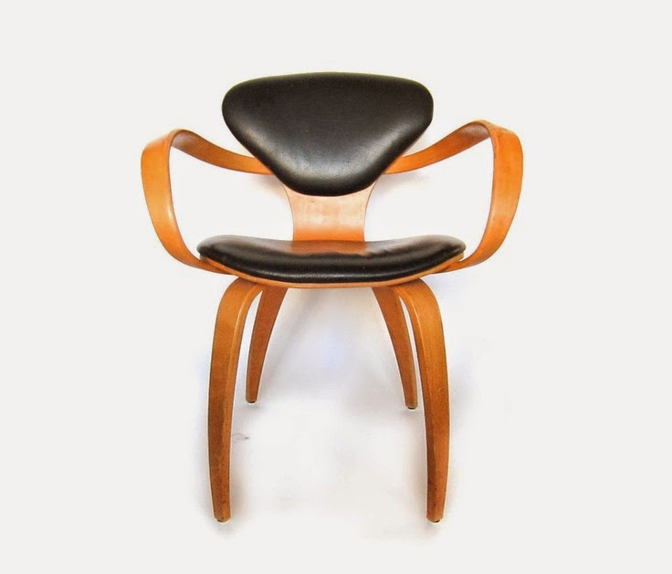 as far as i can tell the cherner midcentury chairs were made a couple different ways both with and without the thin padded seat and back cushions