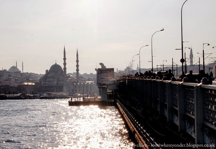 men fishing on Galata Bridge at sunset - Istanbul, Turkey