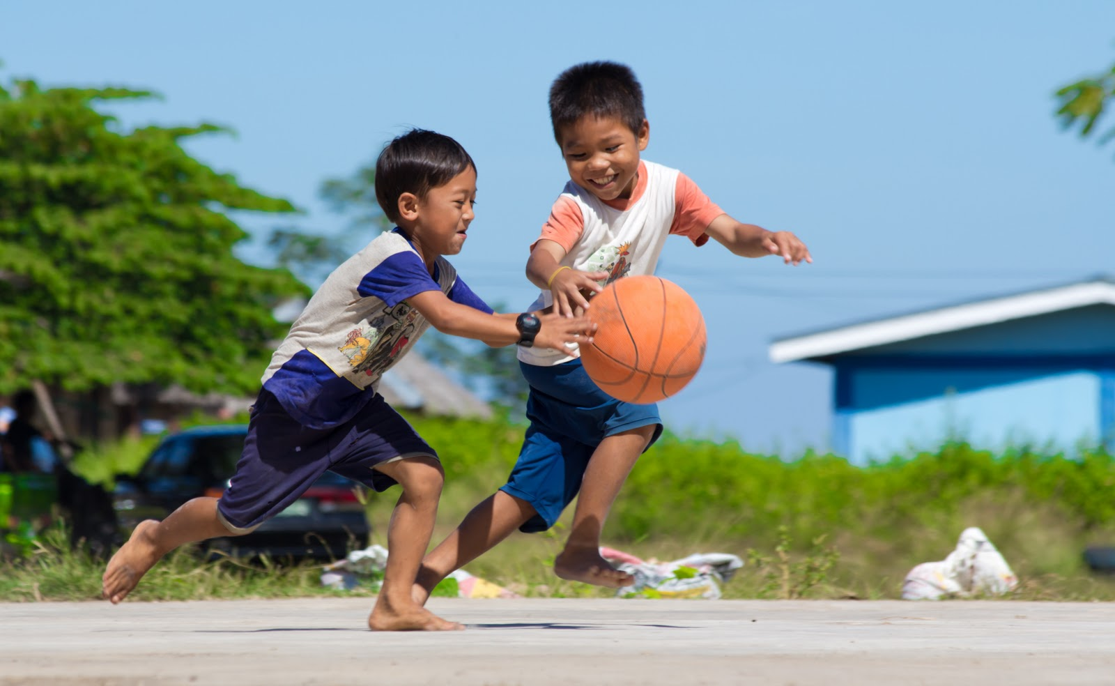 This two kids playing under the scorching heat of the sun running