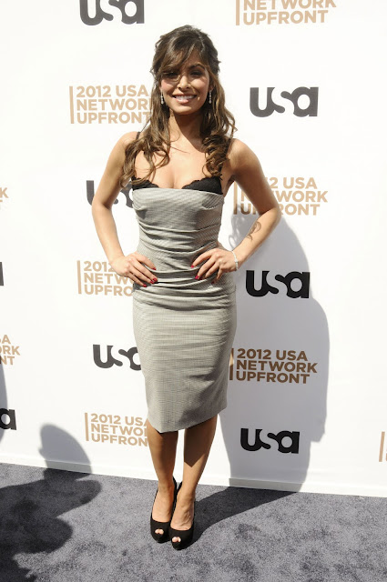 SARAH SHAHI posing for cameras at USA Network Upfront Presentation 2012