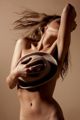 woman covering breasts with hat, model showing skin, topless model, body image, cellulite