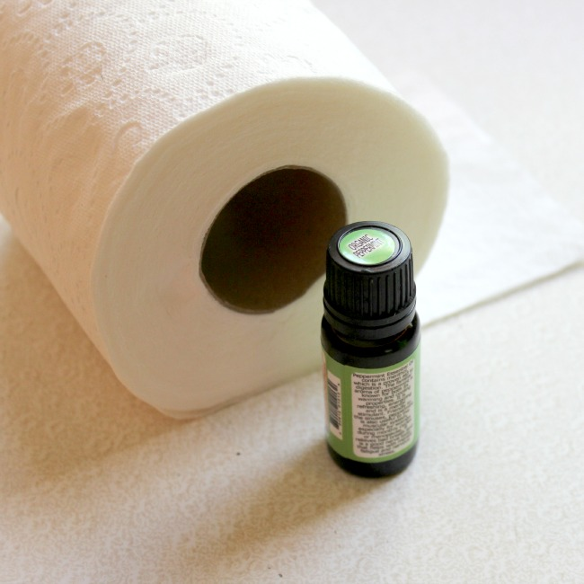 Use essential oil drops inside toilet paper tube to keep bathroom smelling nice.