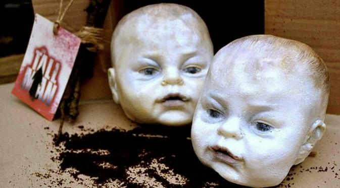 kue seram berbentuk kepala bayi manusia