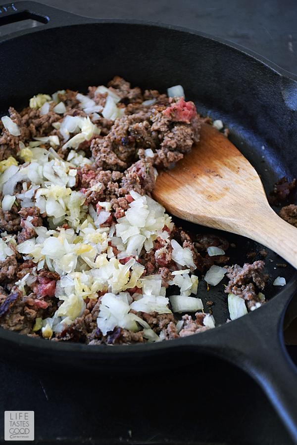 Cheesy Baked Ravioli Skillet | by Life Tastes Good | add onions and garlic