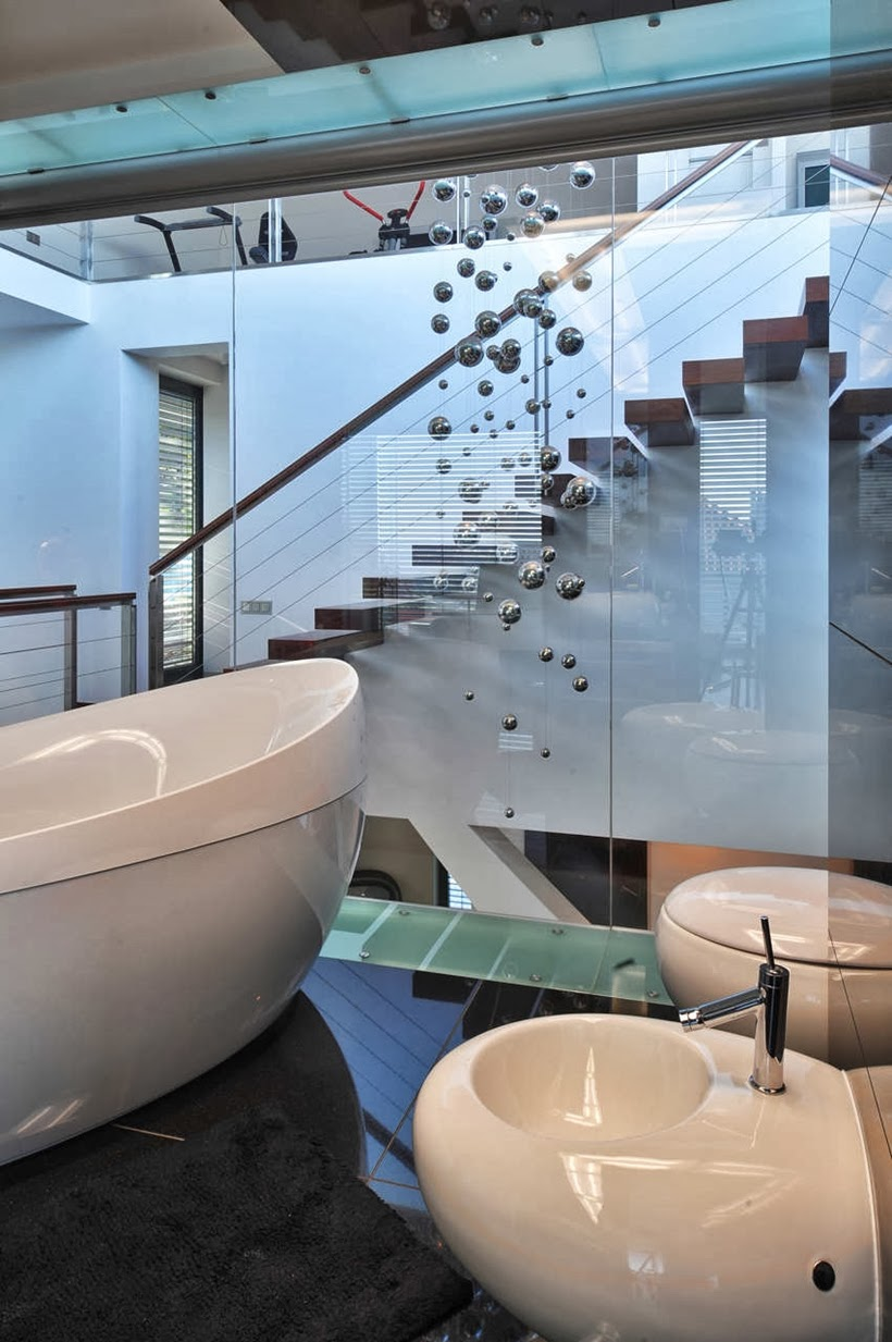 Bathroom glass wall in Modern home in Krakow, Poland