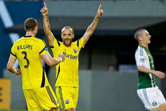 Columbus Crew player Federico Higuaín celebrates after scoring a goal against Portland Timbers