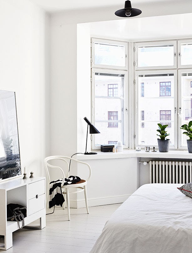 White bedroom with a Thonet Era armchair
