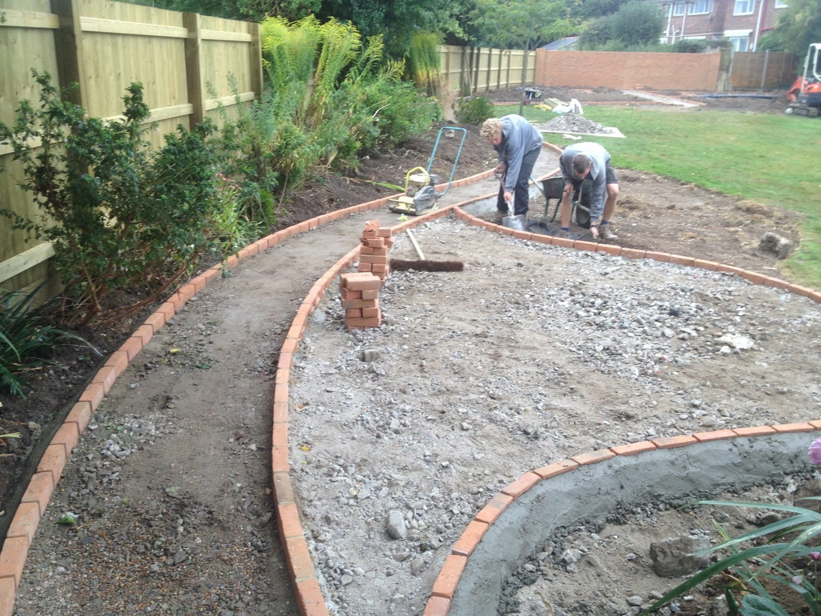 Pathway And Patio Edging Being Installed