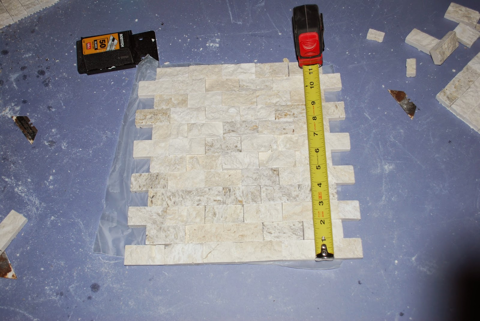 Measure and mark tile for cuts