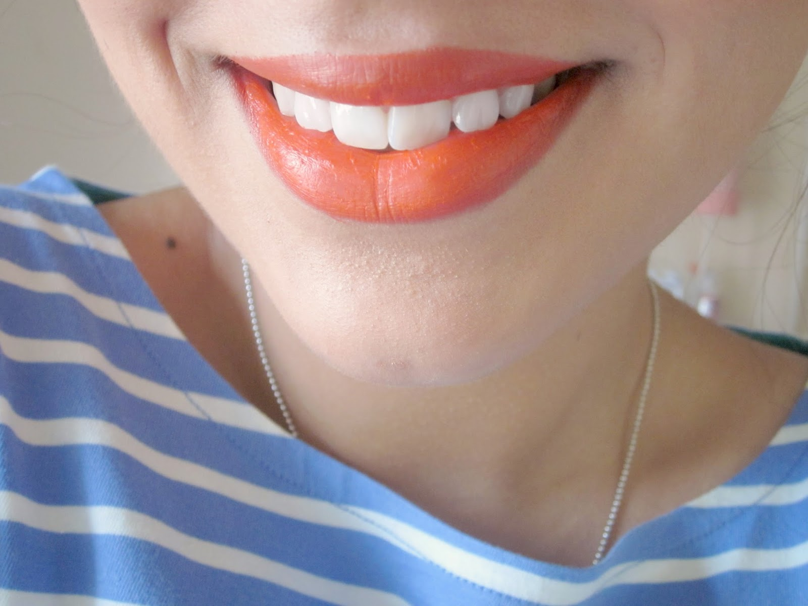 Bellapierre mandarina lipstick swatch on lips