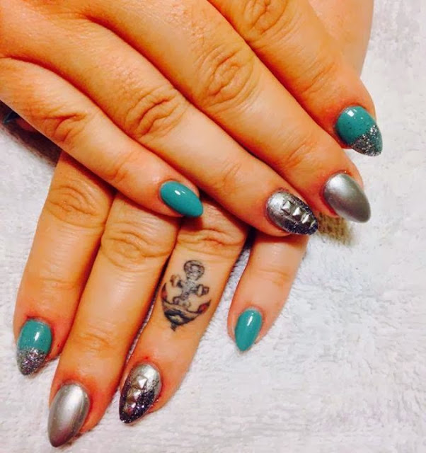 acrylic cusp nails; LED polish 'real teal', 'gunmetal chrome', black & silver haze glitz and silver square studs for feats acrylic nail art design
