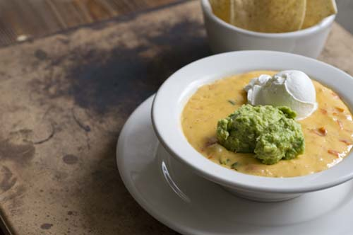 ... Dip: queso with taco meat, guacamole, and sour cream | Homesick Texan
