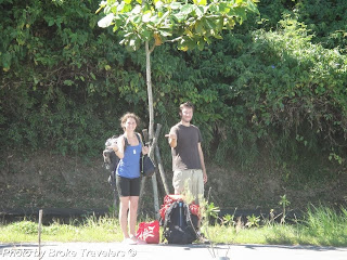 Couple hitchhiking in Hualien Taiwan