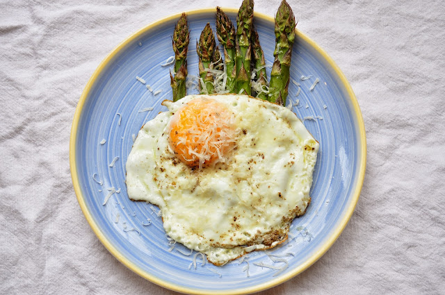Asparagus with a fried egg and parmesan.