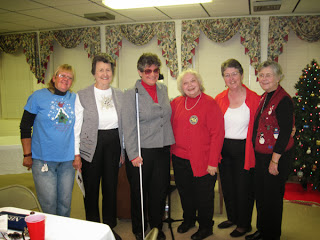Laurel Jean poses with women of Aldersgate United Methodist Church, Hanahan, SC