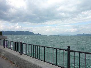 Rough sea along side the Shimanami Kaido Bikeway on IkuchiJima, Island in background