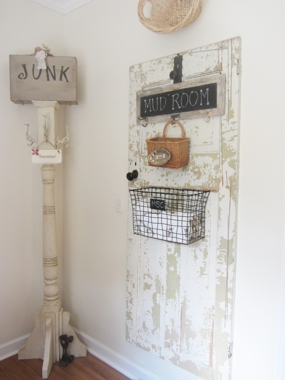 i got the corner coat hanger post from my trip last year to junk bonanza of course i have an old chippy door you know me and my love of old chic laundry room
