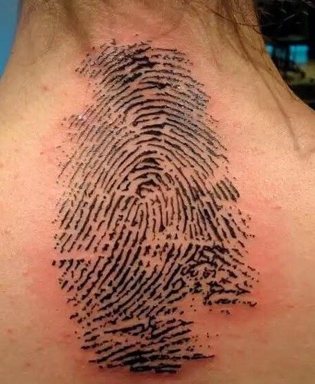 Thumbprint back tattoo