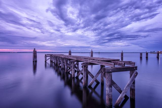 cloudy evening at old pier at lake monroe