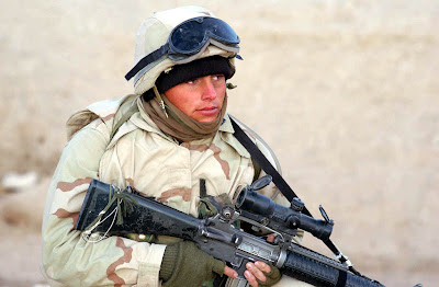HELMAND PROVINCE, Afghanistan (Jan. 01, 2002) -- A U.S. Marine with Battalion Landing Team 3/6, 26th Marine Expeditionary Unit (Special Operations Capable), helps conduct a Cordon and Search Raid at a suspected Al Qaeda hideout in the Helmand Province of Afghanistan.