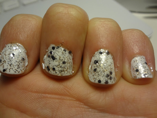 white nail polish with gold and silver glitter