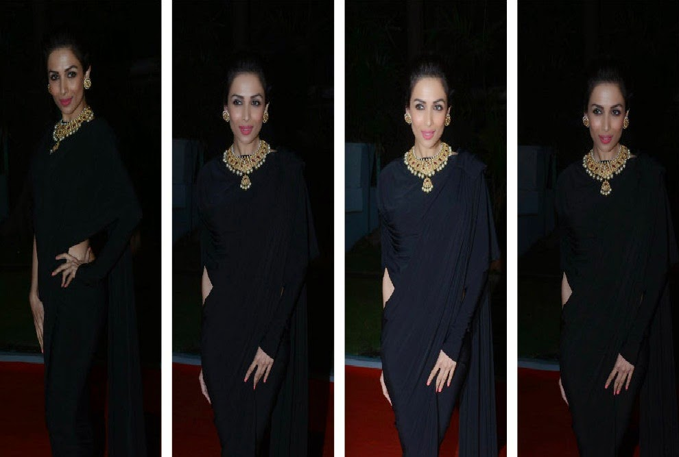 Bollywood Actress Malaika Arora Striking Appearance In Black Plain Saree
