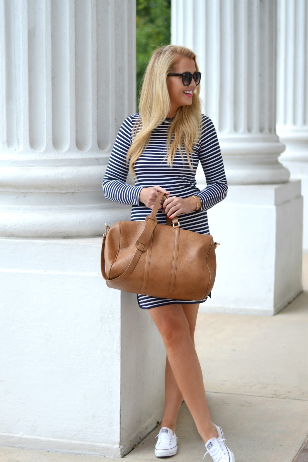 navy and white stripe dress with leather weekender bag