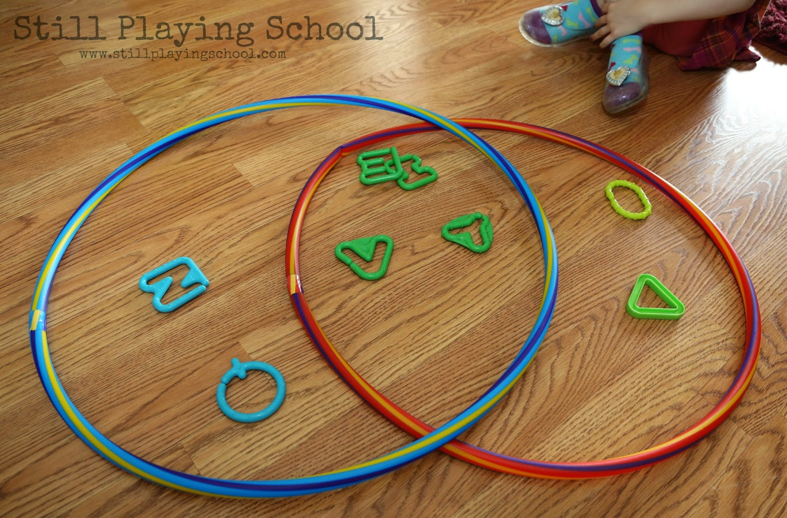 Hula hoop venn diagram sorting still playing school the blue hoop contained bumpy links and the red hoop contained oval links she caught on quickly and wanted to sort them herself pooptronica Gallery