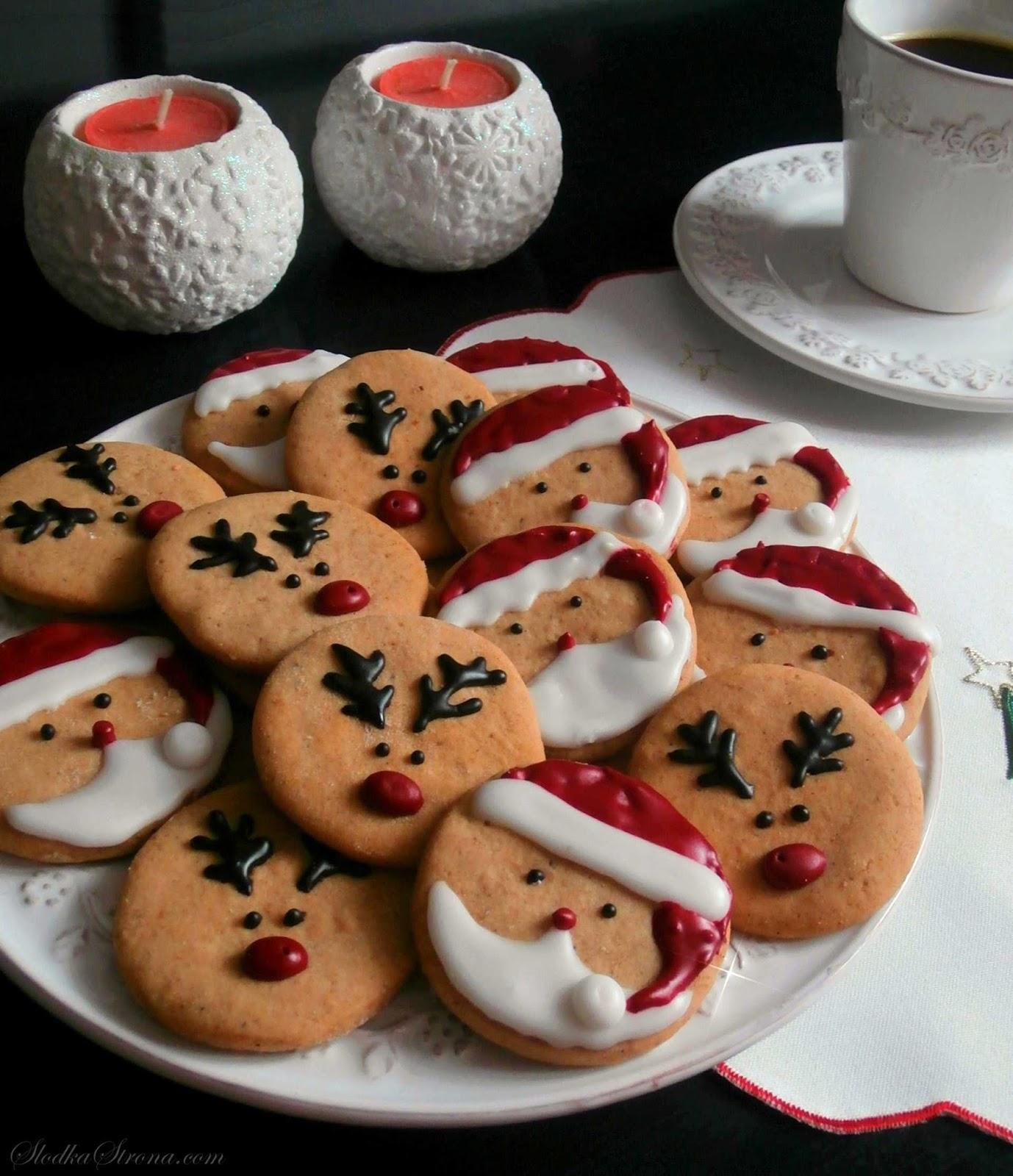 mikołaje i renifery ciasteczka z kolorowym lukrem, ozdoby świateczne na boże narodzenie